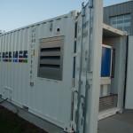 1 Datacontainer, zonnepanelen en windmolen vormen samen datacenter